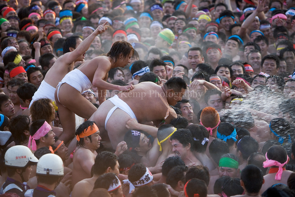 Thousands of men, dressed in fundoshi, the traditional Japanese loincloth, try to touch the Shin Otoko during the Hadaka Matsuri in Konomiya Japan