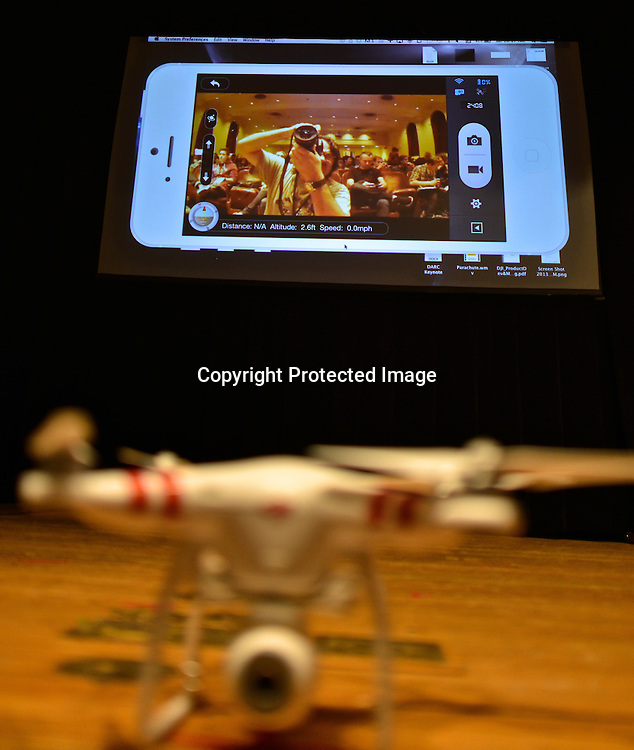 Live broadcasting of audience from the stage by camera onboard a quadcopter drone. Phantom drone during Colin´s Guinn presentation at the Drones and Aerial Robotics Conference (DARC), held at New York University. Guinn is CEO of DJI Innovations, with more than 15 years in aerial photography and component design.