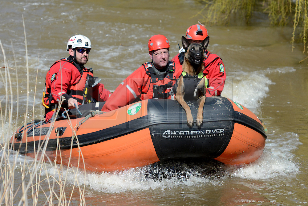 © Licensed to London News Pictures. 29/03/2016. Surrey, UK. Emergency services searching the River Wey in Guildford, Surrey, for a man who disappeared after a kayak capsized as Storm Katie hit Britain on Bank Holiday Monday. Photo credit should read: Emma Sheppard/LNP