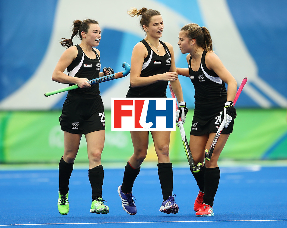 RIO DE JANEIRO, BRAZIL - AUGUST 10:  (L-R) Kelsey Smith of New Zealand celebrates with team mates Pippa Hayward and Rose Keddell of New Zealand as she scores their second goal during the Women's Pool A Match between Spain and New Zealand on Day 5 of the Rio 2016 Olympic Games at the Olympic Hockey Centre on August 10, 2016 in Rio de Janeiro, Brazil.  (Photo by Mark Kolbe/Getty Images)