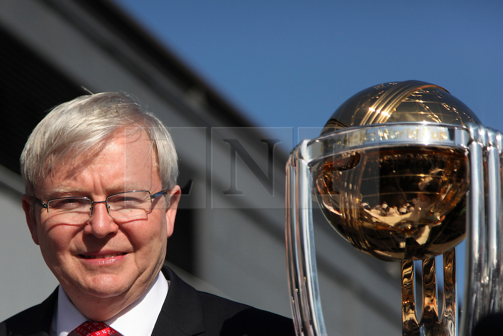 © Licensed to London News Pictures. 30/7/2013. Prime Minister Kevin Rudd poses next to World Cup trophy during the official launch of the I.C.C Cricket World Cup to be held in Australia and New Zealand in 2015, Melbourne, Australia. Photo credit : Asanka Brendon Ratnayake/LNP