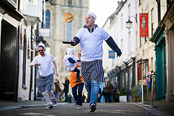 © Licensed to London News Pictures. 28/02/2017. Ripon UK. Chef's from a local restaurant take part in the annual Shrove Tuesday pancake race today at Ripon Cathedral in North Yorkshire. Photo credit: Andrew McCaren/LNP