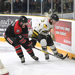"TRENTON, ON  - MAY 5,  2017: Canadian Junior Hockey League, Central Canadian Jr. ""A"" Championship. The Dudley Hewitt Cup. Game 7 between Georgetown Raiders and the Powassan Voodoos. Ryan Takamatsu #8 of the Georgetown Raiders battles for the puck with  Eric Nagy #5 of the Powassan Voodoos during the first period.<br /> (Photo by Andy Corneau / OJHL Images)"