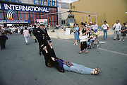 Removing a protestor from the front of French Defense Pavilion at the Paris Air Show, at Le Bourget Airport, France. Held every other year, the event is one of the world's biggest international trade fairs for the aerospace business.