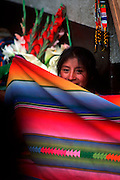 GUATEMALA, MARKETS Chichicastenango, girl selling flowers