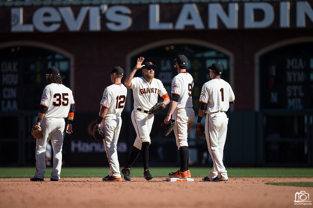 San Francisco Giants right fielder Hunter Pence (8) high fives his teammates after beating the Arizona Diamondbacks at AT&T Park in San Francisco, Calif., on August 31, 2016. (Stan Olszewski/Special to S.F. Examiner)