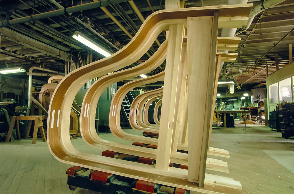 Frames, once pulled from the clamp that shaped them, dry for 10 months at the Steinway Piano factory, Astoria, Queens, New York.