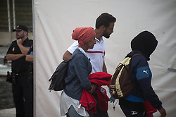 September 30, 2018 - Malaga, MALAGA, Spain - Moroccan migrants women are seen lead by a member of the Spanish Red Cross towards a tent after their arrival at the Port of Malaga..Spain's Maritime Rescue service rescued 96 sub-Saharan and Moroccan migrants aboard two dinghies at the Mediterranean Sea and brought them to Malaga Harbor, where they were assisted by the Spanish Red Cross. (Credit Image: © Jesus Merida/SOPA Images via ZUMA Wire)
