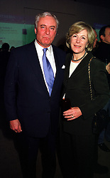 MR & MRS RICHARD HAMBRO members of the banking family, at a party in London on 17th January 2000.OAD 12