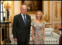 April 4, 2017 - London, United Kingdom - Kylie Minogue at Windsor Castle..The Duke of Edinburgh, Patron of the Britain-Australia Society, presents Kylie Minogue with the Britain-Australia Society Award for 2016 during a private audience in the White Drawing Room at Windsor Castle, in Berkshire. The Britain-Australia Award recognises Australian and British individuals who have made a significant contribution to the Australia-UK bilateral relationship. Past recipients include Barry Humphries, and The Rt Hon Lord Hague PC.  (Credit Image: © i-Images via ZUMA Press)