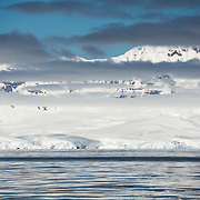 Calm waters in Fournier Bay on the western coast of the Antarctic Peninsula.