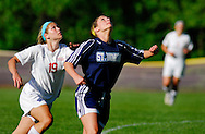 4 MAY 2010 -- ST. LOUIS -- St. Dominic High School girls' soccer player Alexa Cross (19, right ) battles for position with Visitation Academy's  Julia Bartolacci (19) during a game between the St. Dominic and Visitation Academy Tuesday, May 4, 2010 at Visitation in St. Louis. Visitation won the match, 2-1. Photo © copyright 2010 by Sid Hastings.