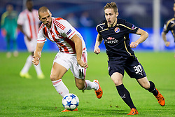 Pajtim Kasami #11 of Olympiakos and Marko Rog #30 of GNK Dinamo Zagreb during football match between GNK Dinamo Zagreb and Olympiakos in Group F of Group Stage of UEFA Champions League 2015/16, on October 20, 2015 in Stadium Maksimir, Zagreb, Croatia. Photo by Urban Urbanc / Sportida