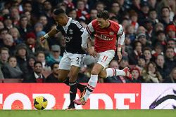 Southampton's Nathaniel Clyne and Arsenal's Mesut Ozil compete for the ball - Photo mandatory by-line: Mitchell Gunn/JMP - Tel: Mobile: 07966 386802 23/11/2013 - SPORT - Football - London - Emirates Stadium - Arsenal v Southampton - Barclays Premier League