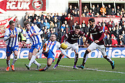 Kilmarnock FC Defender Conrad Balatoni makes a vital block during the Ladbrokes Scottish Premiership match between Heart of Midlothian and Kilmarnock at Tynecastle Stadium, Gorgie, Scotland on 27 February 2016. Photo by Craig McAllister.