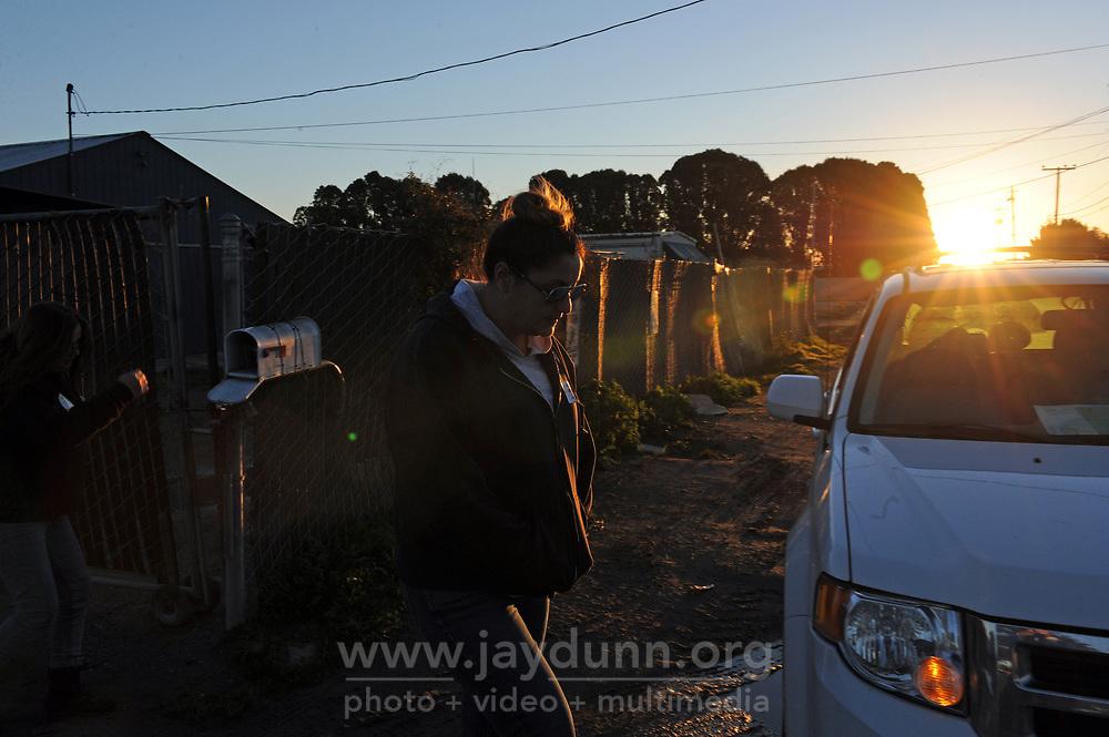 Volunteer Daniela Mejia walks away from an encampment early Wednesday morning.