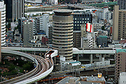 Confluence of the work of Japanese architects and highway engineers in Osaka, Japan resulted in a highway going through a building. (Supporting image from the project Hungry Planet: What the World Eats.)