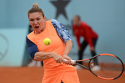 May 11, 2017 - Madrid, Spain - SIMONA HALEP of Romania in her quarterfinal doubles match in the Mutua Madrid Open tennis tournament. (Credit Image: © Christopher Levy via ZUMA Wire)