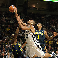 Penn State's D.J. Newbill (2) is fouled driving to the basket by Michigan's Caris LeVert (23) in the first half of an NCAA basketball game in Unversity Park, Pa., Wedneday, February 27, 2013.