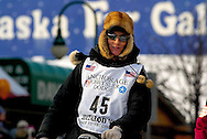 04 March 2006: Anchorage, Alaska - Ryan Redington, grandson of Iditarod co-founder, Joe Redington, heads out for his third Iditarod race during the Ceremonial Start in downtown Anchorage.