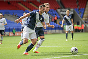 Bailey Wright (Preston North End) runs out of defence with the ball to clear the danger during the Pre-Season Friendly match between Bolton Wanderers and Preston North End at the Macron Stadium, Bolton, England on 30 July 2016. Photo by Mark P Doherty.