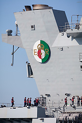 © Licensed to London News Pictures. 23/06/2018. Portsmouth, UK.  The new crest aboard the Royal Navy's flagship, HMS Queen Elizabeth, as she sails into Her Majesty's Naval Base (HMNB) Portsmouth this morning, 23rd June 2018.  The aircraft carrier has been performing trials in the Northern Atlantic, including her first replenishment at sea. She is expected to remain in Portsmouth ahead of aircraft trials off the coast of the United States later this summer.Photo credit: Rob Arnold/LNP
