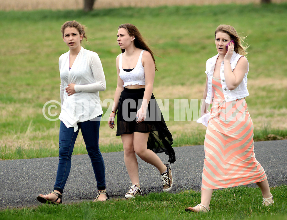 SOUDERTON, PA - APRIL 14:  From left, Amber Figueroa, Hannah Fisher and Sophie Arnott walk from the school building after a bomb threat forced the evacuation of Souderton High School April 14, 2014 in Souderton, Pennsylvania. (Photo by William Thomas Cain/Cain Images)
