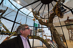 © Licensed to London News Pictures. 13/02/2018. London, UK. American Artist MARK DION inside his installation titled The Library for the Birds of London, 2018. The artwork featuring live birds is part of his first retrospective 'Mark Dion: Theatre of the Natural World showing at the Whitechapel Gallery. Photo credit: Ray Tang/LNP