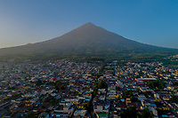 Volcan de Agua (Agua volcano) rises over Ciudad Vieja, Guatemala at sunrise on Tuesday, July 24, 2018. Ciudad Vieja was the second site of Santiago de los Caballeros de Guatemala, the Spanish colonial capital of the country. The volcano is now dormant. Image produced via drone.