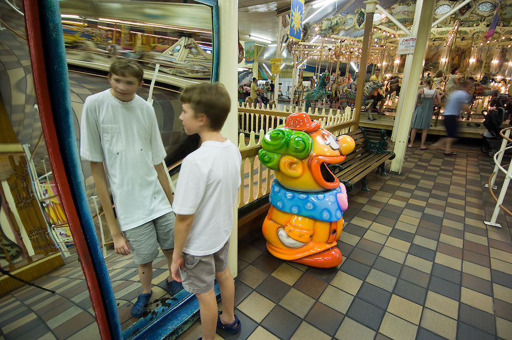 Boy standing at a funhouse mirror in Trimper's Rides, OC, MD