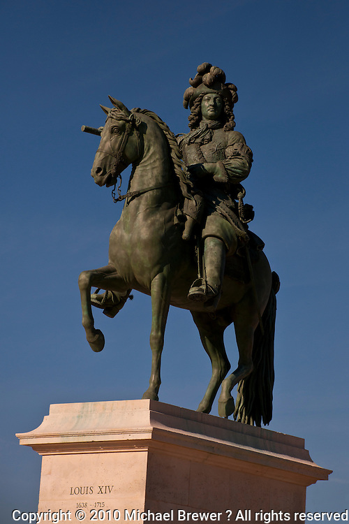 Palace of Versailles. Statue of a mounted King Louis XIV in front of the Palace of Versailles.
