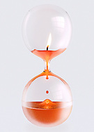 Candle inside sealed hour glass. Flame using up oxygen inside.