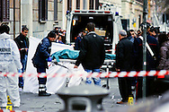 Roma, 1 Marzo 2013.Tentata rapina a un furgone porta valori all'Esquilino.Ilcorpo di Giorgio Frau ex Brigate Rosse ucciso dopo la tentata rapina ad un furgone porta valori in Via Carlo Alberto, viene portato via dalla polizia mortuaria.