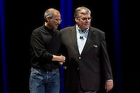 SAN FRANCISCO, CA - JANUARY 9: Apple CEO Steve Jobs greets Stan Sigman, president and CEO of Cingular during the keynote speech at Macworld on January 9, 2007 in San Francisco, California. During the keynote Apple CEO Steve Jobs introduced the new iPhone which will combine a mobile phone, a widescreen iPod with touch controls and a internet communications device with the ability to use email, web browsing, maps and searching. The iPhone will start shipping in the US in June 2007. (Photograph by David Paul Morris)