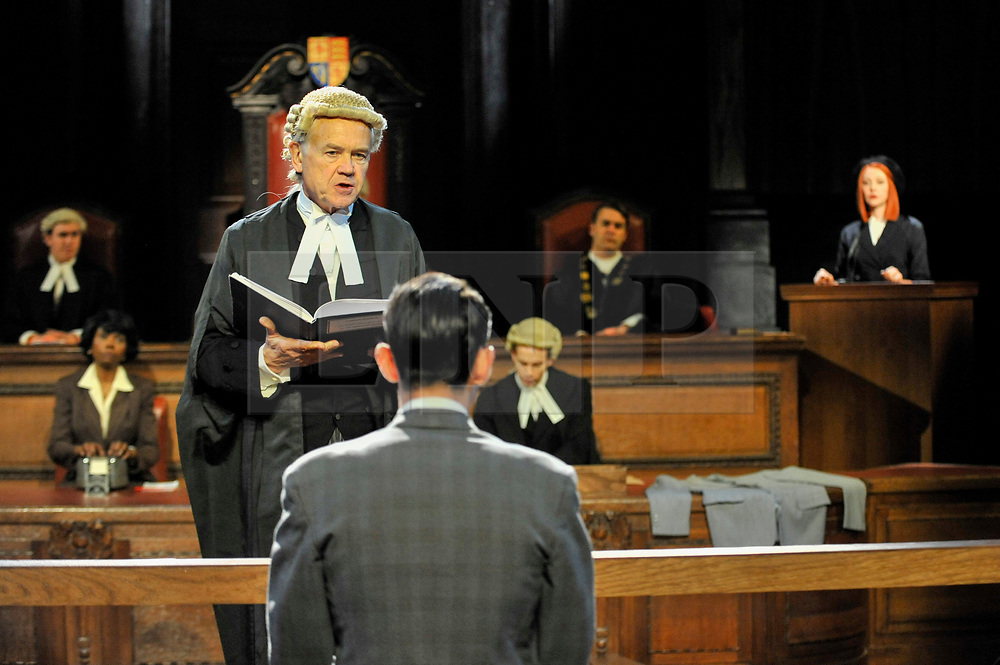 """© Licensed to London News Pictures. 20/10/2017. London, UK. David Yelland as Sir Wilfrid Robarts addresses Jack McMullen as Leonard Vole, the accused. Photocall for """"Witness for the Prosecution"""", by Agatha Christie, directed by Lucy Bailey, at London County Hall.  The play opens 23 October. Photo credit : Stephen Chung/LNP"""