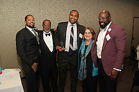 The Hyde Park Chamber of Commerce held its 75th Annual Chamber Dinner this past Thursday. The event was held at Rodfei Zedek located at 5200 S. Harper.<br /> <br /> 8910 – Hyatt Hotel staff members Maurese Nelson (1st person), Anthony Beach (3rd person), and Leroy Brown Jr (5th person) accepted the award for business of the year with Executive Director for the Hyde Park Chamber of Commerce, Wallace Goode (2nd person) and Joyce Feuer of Joyce's Events and Party Planning (4th person)
