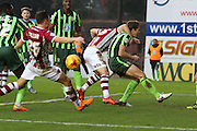 Paul Robinson of AFC Wimbledon gets a headlock as he defends another attack during the Sky Bet League 2 match between Exeter City and AFC Wimbledon at St James' Park, Exeter, England on 28 December 2015. Photo by Stuart Butcher.