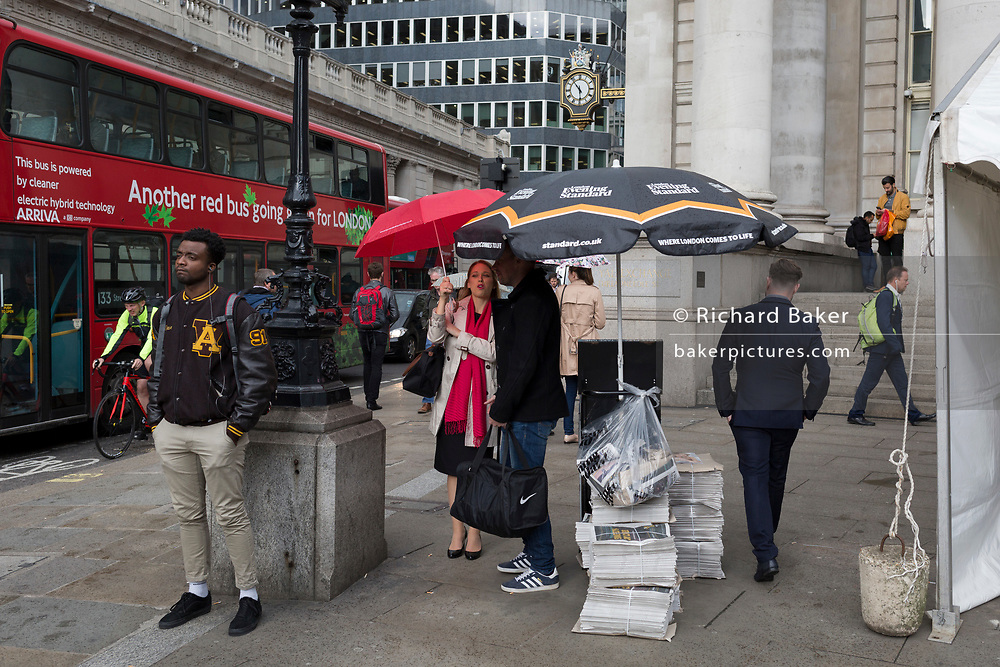 Rush-hour rain shower during the rush-hour at Cornhill, on 19th May 2017, in the City of London, England.