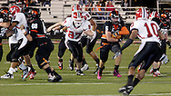 Senior Tony Peters (10) and junior TJ Fryer (87) go after senior Zach Smith (5) in the first quarter as the Wayne Warriors play the Beavercreek High School Beavers at the Frank Zink Field in Beavercreek, Friday, October 7, 2011.
