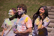 Bindi Kumar, right, photo bombs Chu Wu and Rishi Patel's picture during the Holi Festival of Color organized by Ohio University's Indian Students Association Saturday March 15, 2014.  Photo by Ohio University / Jonathan Adams