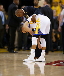The Golden State Warriors' Stephen Curry is checked following a scuffle against the Cleveland Cavaliers in the second quarter of Game 5 of the NBA Finals at Oracle Arena in Oakland, Calif., on Monday, June 12, 2017. (Photo by Nhat V. Meyer/Bay Area News Group/TNS) *** Please Use Credit from Credit Field ***
