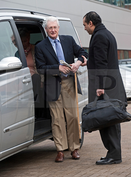© Licensed to London News Pictures. 24/02/2012. Heathrow, UK. Christopher Tappin being helped from a taxi as he arrives at Heathrow Police station to surrender for extradition the the USA. Tappin is charged with conspiring to export defence articles without licence or approval in relation to the sale of batteries that were allegedly used in Iranian surface-to-air missiles. Photo credit : Ben Cawthra/LNP