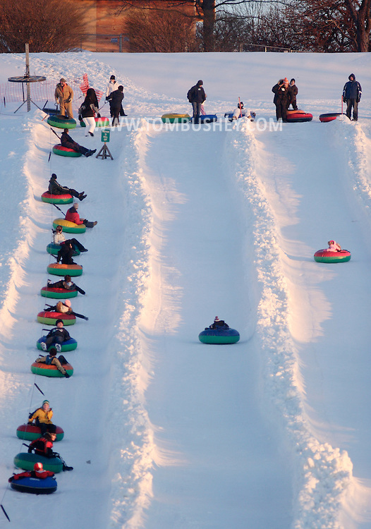 Hamptonburgh, NY - People slide down the snow tubing hill at Thomas Bull Memorial Park late in the afternoon on Feb. 16, 2008.