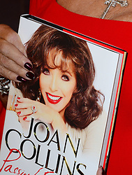 Joan Collins book signing. <br /> Iconic English actress, author and columnist signs copies of her memoir Passion For Life. The book picks up where her second autobiography, Second Act, ended. Selfridges, London, United Kingdom. Saturday, 26th October 2013. Picture by Nils Jorgensen / i-Images