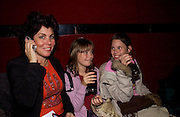 Madeleine ( taller) , Ruby Wax and Marina, European premiere of Cirque de Soleil's Dralion, Royal Albert Hall and afterwards at the Natural History Museum, 8 January 2003.  .© Copyright Photograph by Dafydd Jones 66 Stockwell Park Rd. London SW9 0DA Tel 020 7733 0108 www.dafjones.com