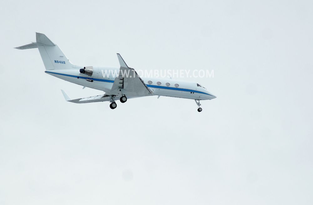 Town of Newburgh, NY - A Gulfstream Aerospace G-IV jet with it landing gear down approaches Stewart International Airport on Feb. 27, 2008.