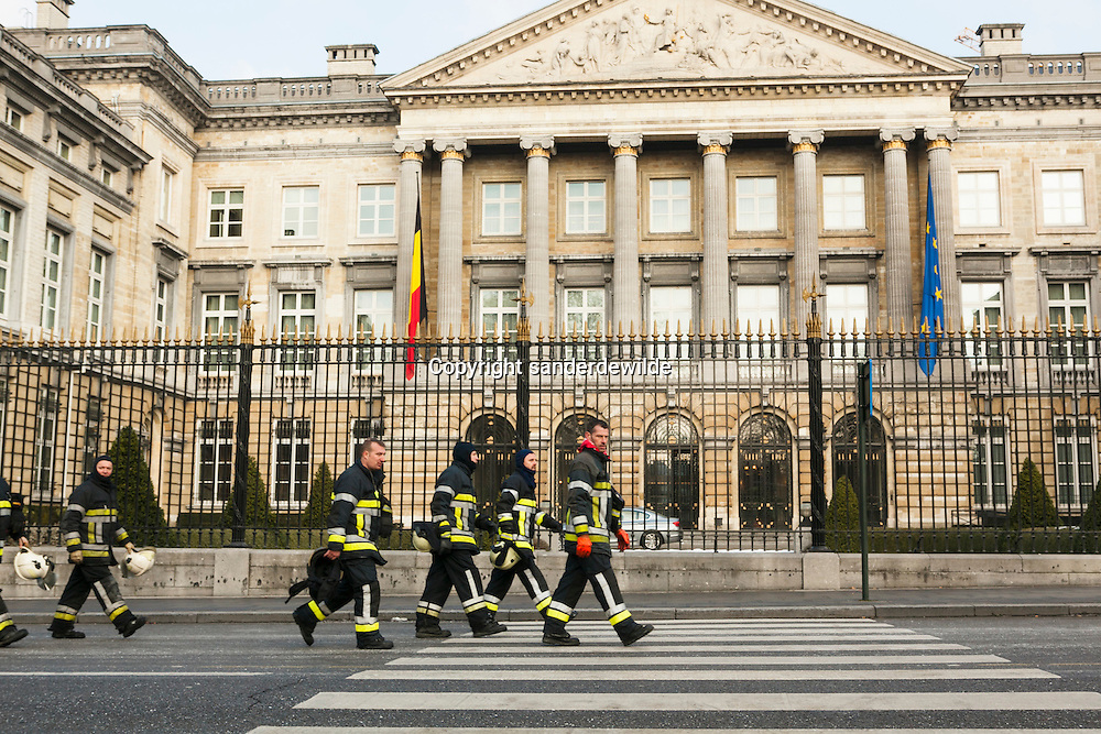 Belgian Firemen attack the government buildings in Brussels.They do not agree with reforms of pensions by the new government. After breaking through the police fence, they put water and foam on the Lawstreet 10, office of the Prime minister. Brussels, Belgium, 10th February 2012.