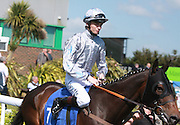 Jockey William Twiston-Davies on Heading To First in the Parade Ring before the 3.50 race at Brighton Racecourse, Brighton & Hove, United Kingdom on 10 June 2015. Photo by Bennett Dean.