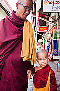 Senior monk with young boy monk. Yangon, Myanmar.