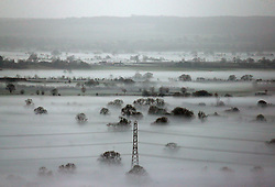 © Licensed to London News Pictures. 25/01/2014. Somerset, UK. Fog on the Somerset Levels near Glastonbury at Sunrise today. Photo credit : Jason Bryant/LNP